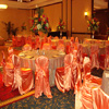 orange satin chair and table covers